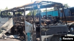 A bus that was damaged in a bomb blast is seen outside Burgas Airport, about 400km (248miles) east of Sofia, Bulgaria, July 19, 2012.