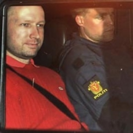 Norway's twin terror attacks suspect Anders Behring Breivik, left, sits in an armored police vehicle after leaving the courthouse following a hearing in Oslo, July 25, 2011