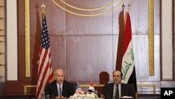 美國副總統拜登和伊拉克總理馬利基星期三在巴格達的聯合新聞發佈會上
