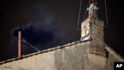 Black smoke emerges from chimney of Sistine Chapel, March 12, 2013.