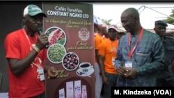 At the annual coffee festival, Cameroon officials encourage people to drink coffee, April 17, 2019, in Yaounde, Cameroon.