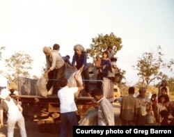 Food is unloaded in a refugee camp in Thailand in November 1979. (Photo courtesy of Greg Barron)