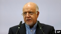 FILE - Iran's Oil Minister Bijan Zanganeh speaks during the Iran Petroleum Contracts Conference in Tehran, Iran, Nov. 28, 2015.