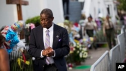 Church member Thomas Rose leaves a wake for Sen. Clementa Pinckney, one of the nine killed in last week's shooting at Emanuel AME Church, June 25, 2015, in Charleston.