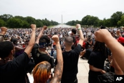 Demonstrators protest June 6, 2020, at the Lincoln Memorial in Washington, over the death of George Floyd, a black man who was in police custody in Minneapolis.