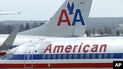 American Airlines planes sit at a gate at Washington's Ronald Reagan National Airport.