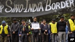 Exile Tibetan protesters mourn for Tibetan victims of self-immolation during a protest in New Delhi, India, Tuesday, Jan. 17, 2012. The protest was against lack of Tibetan representation in the ongoing border talks between India and China in New Delhi. (A