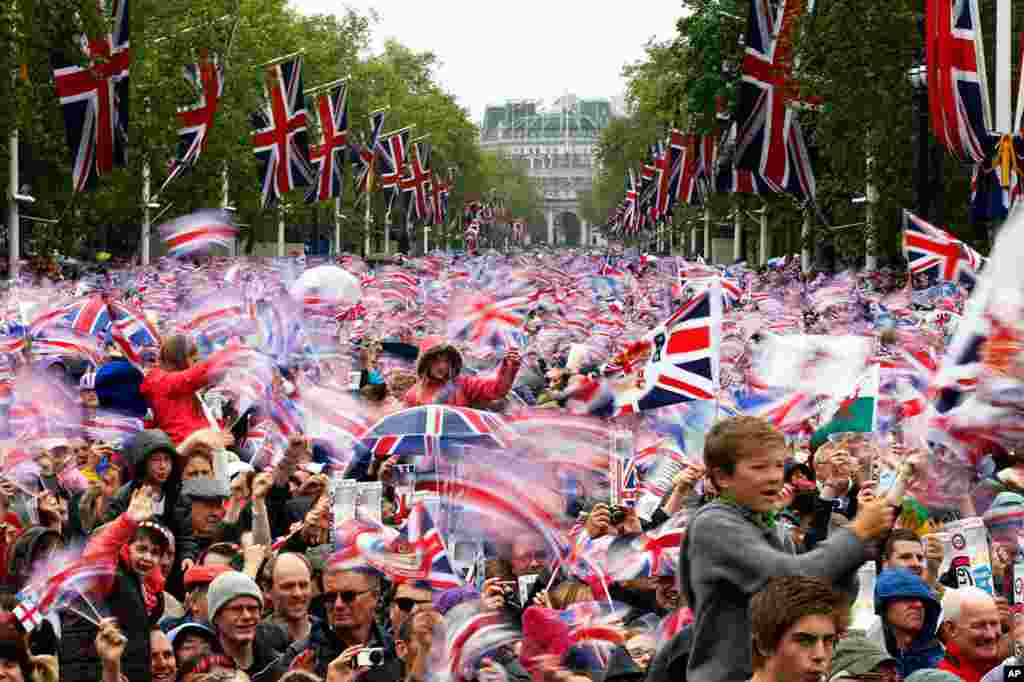 June 5: Revelers in London watch Britain's Queen Elizabeth appear on the Buckingham Palace balcony as part of Diamond Jubilee celebrations to mark the 60th anniversary of her accession to the throne.