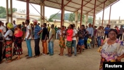 FILE - Congolese people line up to receive a vaccination against yellow fever in the Gombe district of the Democratic Republic of Congo's capital, Kinshasa, Aug. 17, 2016.