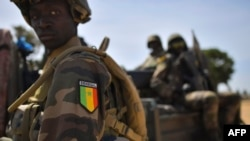 FILE - Senegalese soldiers membrers of ECOWAS forces (Economic Community of West African States) patrol in Barra, Jan. 22, 2017.