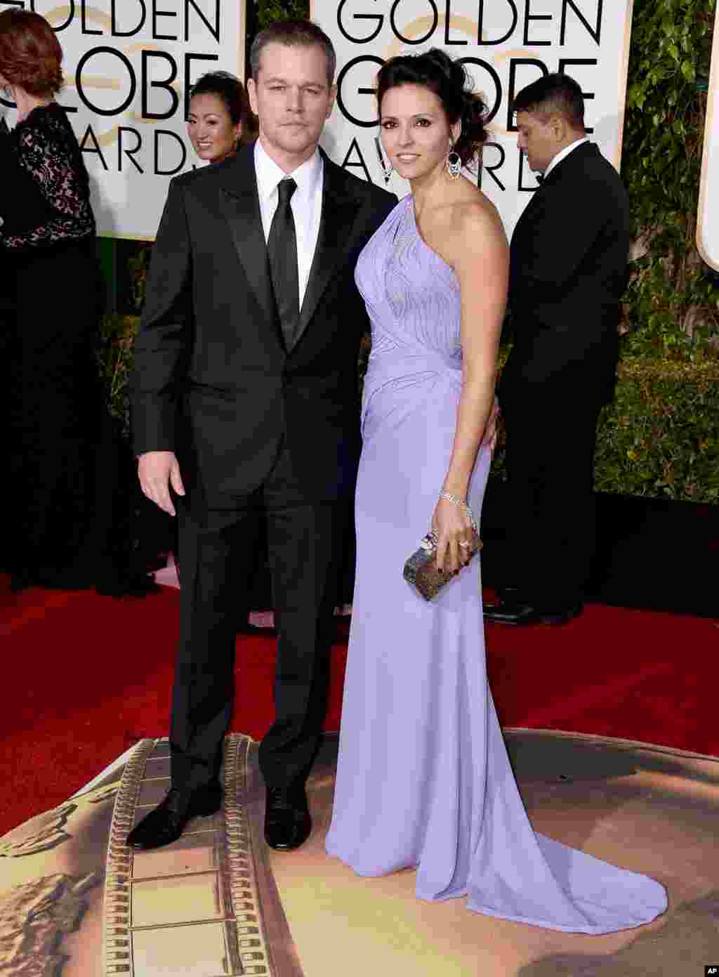 Matt Damon, left, and Luciana Barroso arrive at the 73rd annual Golden Globe Awards on Jan. 10, 2016, at the Beverly Hilton Hotel in Beverly Hills, Calif.