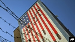 An anti-U.S. mural is seen on a wall of a government building in central Tehran, Iran, October 12, 2011.