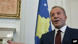 Kosovo's President Behgjet Pacolli, gestures during an interview with The Associated Press in his office, hours before Kosovo's top court is to disclose details of a ruling saying Pacolli's election violated the constitution, in capital Pristina, March 30