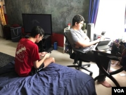 Dora Mekouar's sons, unexpectedly home from college, are now taking their final exams online. (Dora Mekouar/VOA)
