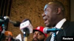 The elder Michael Brown watches attorney Benjamin Crump speak during a news conference in Ferguson, Missouri, Nov. 25, 2014.