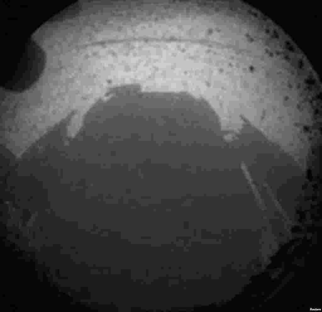 One of the first views from NASA's Curiosity rover, which landed on Mars on August 5, 2012. It was taken through a wide-angle lens on one of the rover's Hazard-Avoidance cameras.