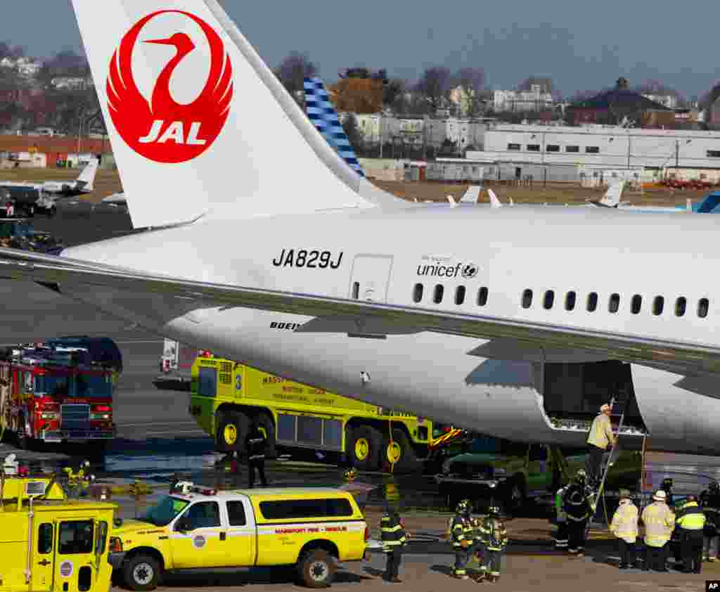 A Japan Airlines Boeing 787 Dreamliner jet surrounded by emergency vehicles at Logan International Airport in Boston, January 7, 2013. A small electrical fire filled the cabin of the JAL aircraft with smoke.