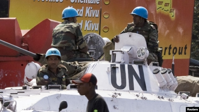 Soldiers with the UN peacekeeping force sit on top of an armored personnel carrier in the center of Goma, Eastern DRC, December 6, 2008.