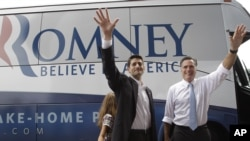 Republican presidential candidate, former Massachusetts Gov. Mitt Romney, right, and vice presidential candidate Wisconsin Rep. Paul Ryan are joined by Ryan's daughter Liza as they wave to the crowd, Aug. 11, 2012, in Norfolk, Va.