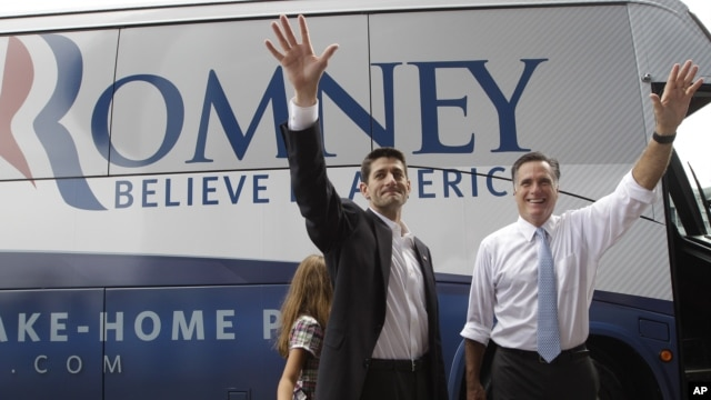 Republican presidential candidate, Mitt Romney, right, and vice presidential candidate Paul Ryan wave to the crowd in Norfolk, Virginia, August 11, 2012.