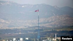 FILE - A North Korean flag is seen on top of a tower near the truce village of Panmunjom in the demilitarised zone (DMZ) separating North Korea from South Korea, about 55 km north of Seoul.