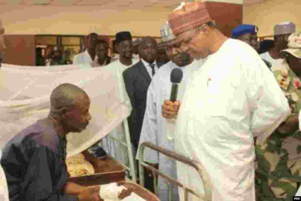 Gov. Gaidam of Yobe State sympathizing with one of the victims of Potiskum cattle market attack at the General hospital in Potiskum. The market was yesterday night attacked by unknown gunmen where they set a blaze the market killing over 50.