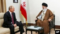 FILE - In this picture released by the office of Iran's supreme leader, Ayatollah Ali Khamenei, right, speaks with Russian President Vladimir Putin during their meeting in Tehran, Iran, Nov. 1, 2017.
