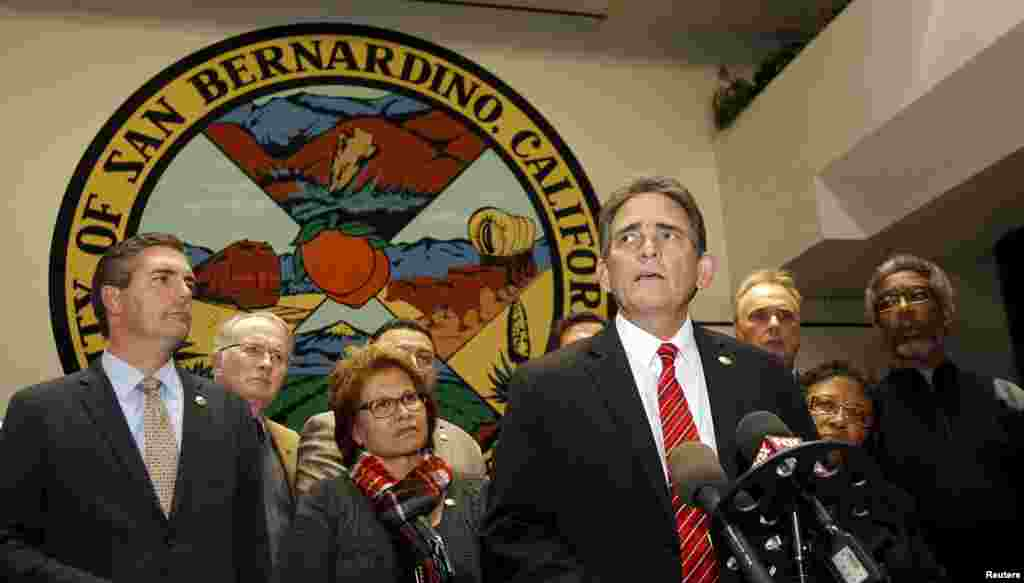 Mayor Carey Davis (C) talks to the media, after an emergency city council meeting, with all of the council behind him, about the shooting rampage at the Inland Regional Center, where gunmen shot and killed several people and injured others in San Bernardino, California, Dec. 2, 2015.