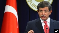 Turkish Foreign Minister Ahmet Davutoglu speaks to the media in Ankara, Turkey, September 2, 2011.