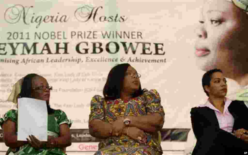"""Liberian Minister for Gender and Development Vabah Kazaku Gayflor, left, Nobel laureate Leymah Gbowee, center, and Dr. Ndidi Nnoli Edozien attend a talk during a visit to Lagos, Nigeria, Friday, Dec. 2, 2011. Gbowee warned against """"godfatherism"""" in politi"""