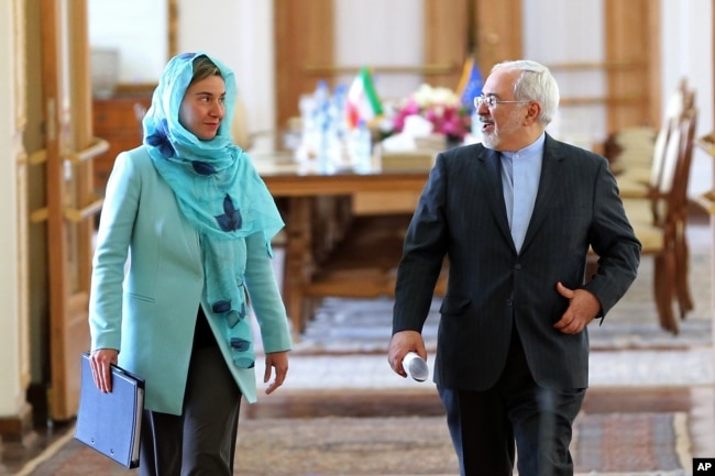 FILE - Iranian Foreign Minister Mohammad Javad Zarif and European Union foreign policy chief Federica Mogherini arrive to attend a press briefing after their meeting in Tehran, Iran, April 16, 2016.