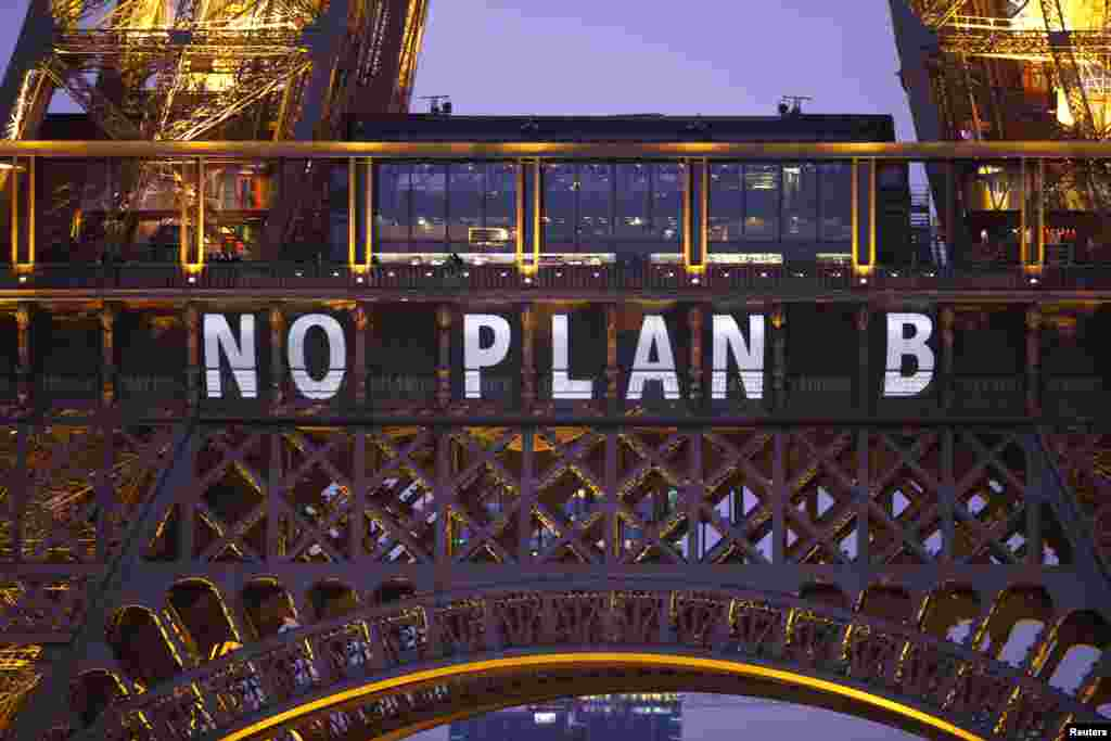 "The slogan ""No Plan B"" is projected on the Eiffel Tower as part of the World Climate Change Conference 2015 (COP21) in Paris, France."