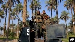 Tentara Irak yang berpatroli di Jurf al-Sakhar, 70 kilometer di selatan Baghdad.