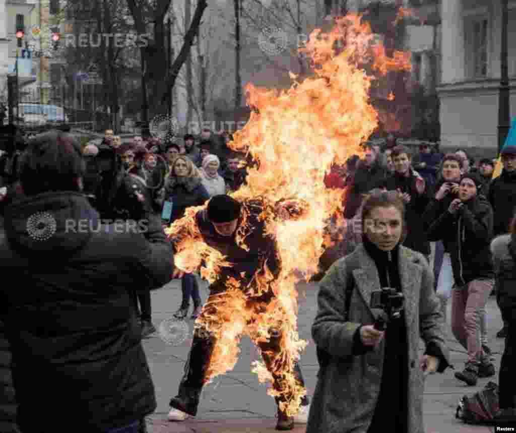 A man who called himself Oleksandr Burlakov, sets himself on fire during a protest rally outside the presidential office in Kyiv, Ukraine, to draw the attention of the authorities to his plight of the land ownership.