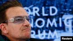 FILE - Singer Bono attends a session at the annual meeting of the World Economic Forum (WEF) in Davos, Switzerland, Jan. 24, 2014.