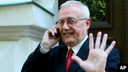 FILE - In this photo taken May 24, 2012, Josip Perkovic, suspected ex-Yugoslav secret police member, gestures as he uses a mobile phone outside a court in Zagreb, Croatia.