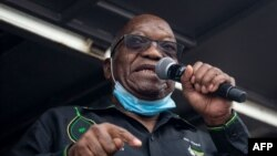 (FILES) In this file photo taken on July 04, 2021 Former South African president Jacob Zuma addresses his supporters in front of his rural home in Nkandla for the first time since he was given a 15-months sentence for contempt of court. - South…