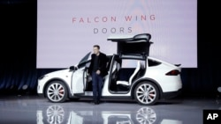 Elon Musk, CEO of Tesla Motors Inc., introduces the Model X car at the company's headquarters in Fremont, Calif., Sept. 29, 2015.