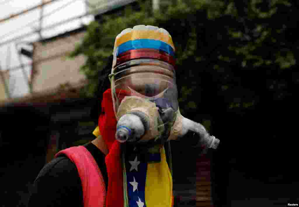 A demonstrator wears a homemade gas mask during a rally against Venezuela's President Nicolas Maduro in Caracas, May 1, 2017.