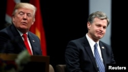 FILE - U.S. President Donald Trump and FBI Director Christopher Wray participate in a graduation ceremony at the FBI Academy on the grounds of Marine Corps Base Quantico in Quantico, Virginia, U.S. Dec. 15, 2017.