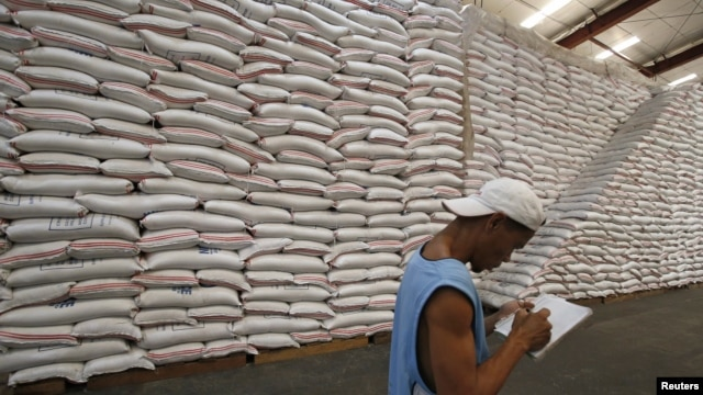 A National Food Authority (NFA) worker makes an inventory of rice stocks at a government rice warehouse in Taguig, Metro Manila, March 11, 2014.