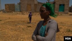 Letay Girmay, 50, says she and other Hawzen residents buried the bodies of many civilians after battles in Hawzen, Ethiopia, on June 6, 2021. (VOA/Yan Boechat)