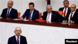 FILE - Turkey's main opposition Republican People's Party leader Kemal Kilicdaroglu speaks at the Turkish parliament in Ankara, Turkey, July 15, 2017.