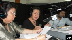 """Lim Mony, deputy head of the women's section for the rights group Adhoc, and Hor Malin, undersecretary of state for the Ministry of Women's Affairs, on """"Hello VOA"""" Monday."""