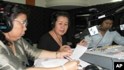 "Lim Mony, deputy head of the women's section for the rights group Adhoc, and Hor Malin, undersecretary of state for the Ministry of Women's Affairs, on ""Hello VOA"" Monday."