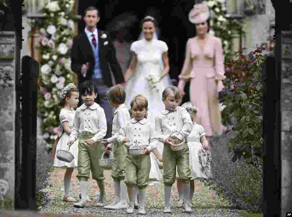 Britain's Prince George, foreground center, reacts after the wedding of his aunt, Pippa Middleton to Hedge Fund manager James Matthews, at St Mark's Church in Englefield, England, May 20, 2017.