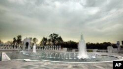 With all of the fountains turned on, workers put the final touches on the World War II Memorial. File photo.