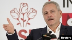FILE - Leader of Romania's leftist Social Democrat Party (PSD), Liviu Dragnea, gestures during a press conference following the end of the parliamentary elections, in Bucharest, Romania, Dec. 11, 2016.