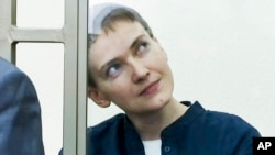 Nadiya Savchenko is seen in a glass cage during court proceedings against her in the town of Donetsk, in Russia's Rostov-on-Don region, March 21, 2016.