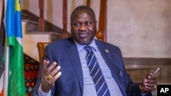 FILE - South Sudan rebel leader Riek Machar talks to reporters at his private residence in the Ethiopian capital, Addis Ababa, Feb. 13, 2016. He says he is ready to return to Juba in March to take up his position as first vice president.